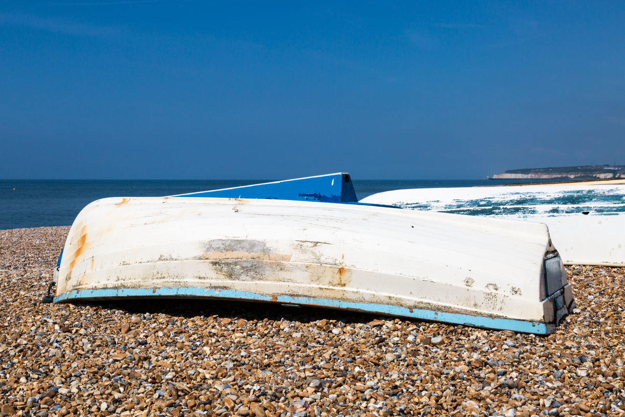 Fishing Boats on a Beach Abandoned Beach Blue Clear Sky Damaged Day Horizon Over Water Moored Nature Nautical Vessel No People Outdoors Pebble Beach Pebbles Scenics Sea Seaford Sky Transportation Water