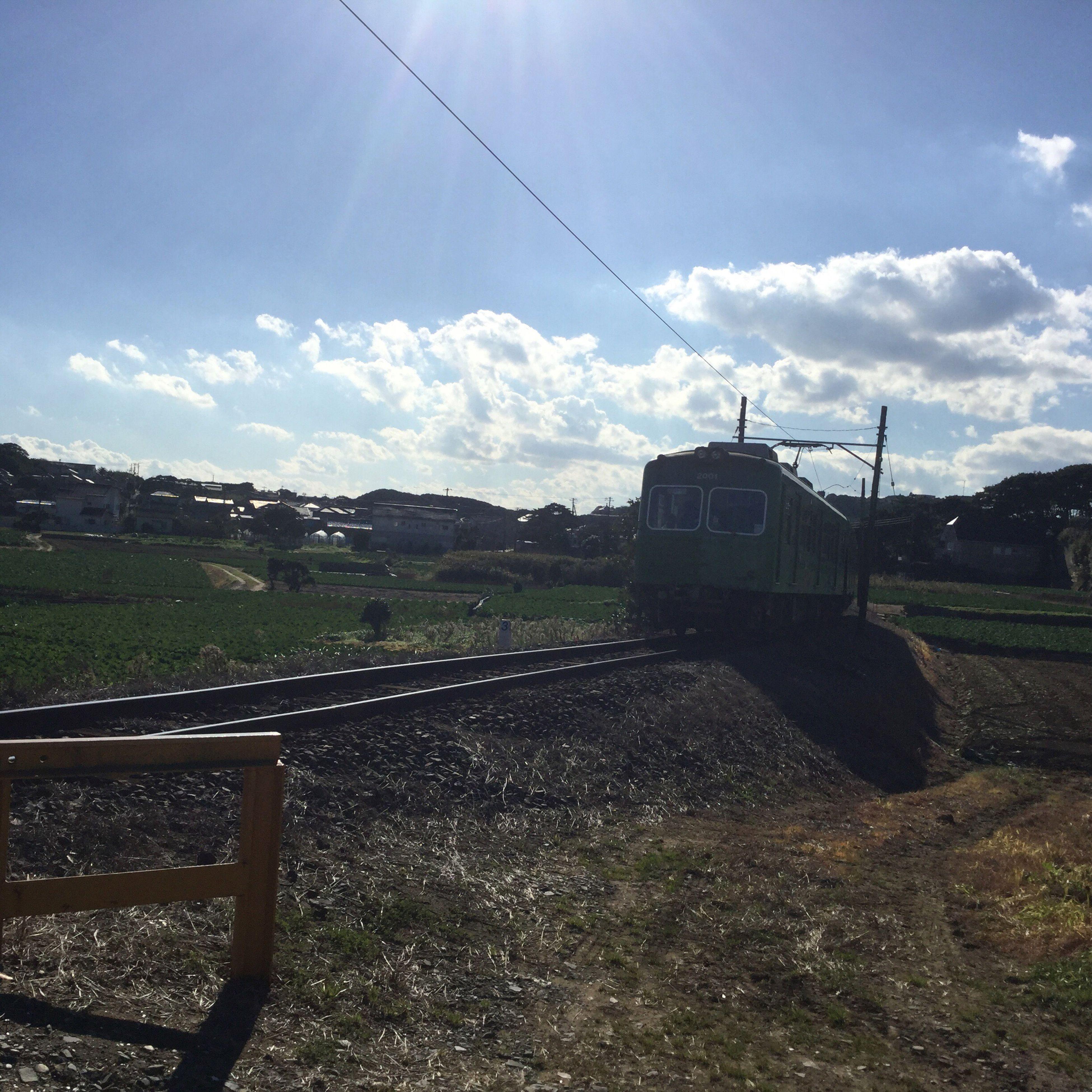 field, landscape, rural scene, sky, agriculture, farm, transportation, grass, sunlight, cloud - sky, tranquil scene, tranquility, cloud, nature, day, grassy, horizon over land, sunbeam, scenics, road