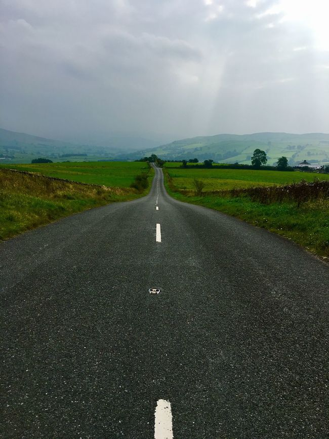 Roadtonowhere Road To Nowhere Countryside Country Road The Way Forward Transportation Landscape Diminishing Perspective Field Tranquil Scene Road Vanishing Point Road Marking Sky Tranquility Nature Outdoors Scenics Non-urban Scene Cloud - Sky Mountain Day Solitude Grassy