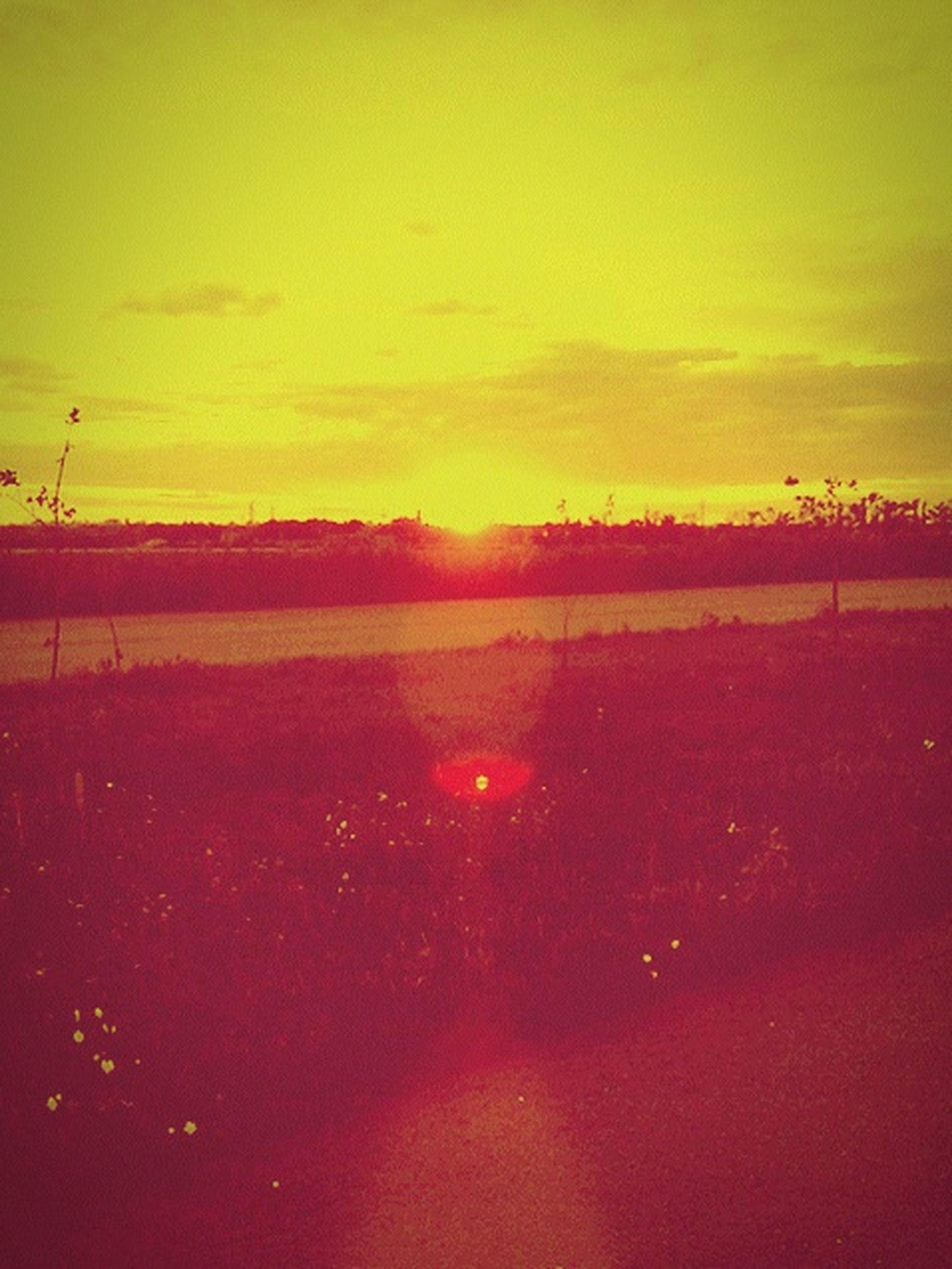 sunset, tranquil scene, scenics, tranquility, beauty in nature, sky, orange color, water, idyllic, nature, sun, landscape, sea, cloud - sky, beach, horizon over water, non-urban scene, remote, silhouette, outdoors