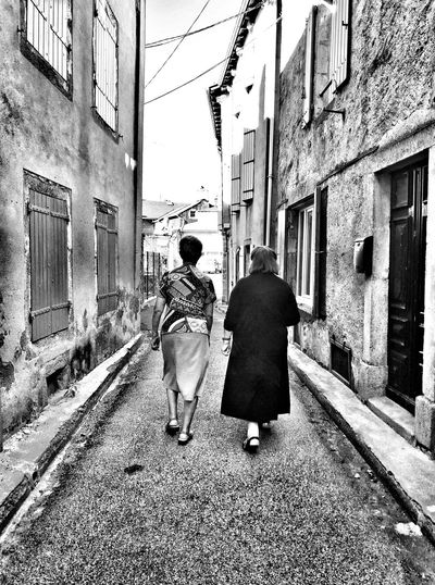 Walking Built Structure Real People Lifestyles Outdoors Women People Street Architecture Blackandwhite France Eye4photography  EyeEmBestPics Blackandwhite Photography Bnw EyeEm Best Shots Streetphotography