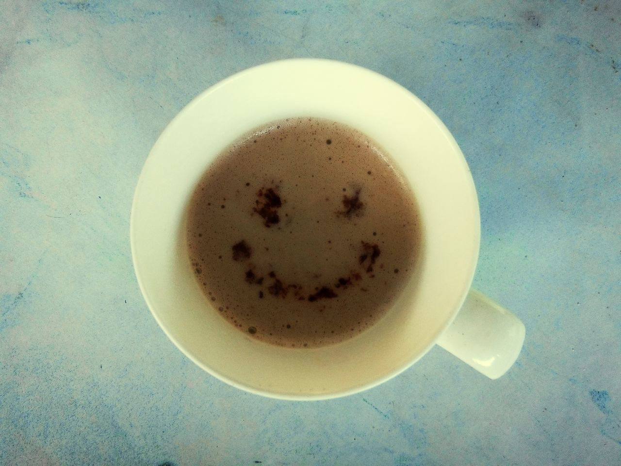 Directly Above Shot Of Coffee Cup With Smiley Face