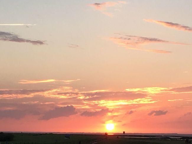 Nordseeküste Beauty In Nature Sunset Scenics Sun Tranquil Scene Tranquility Orange Color Idyllic Sky Landscape Majestic Nature Environment Atmosphere Cloud - Sky Back Lit Cloud Sunbeam Romantic Sky Tourism First Eyeem Photo