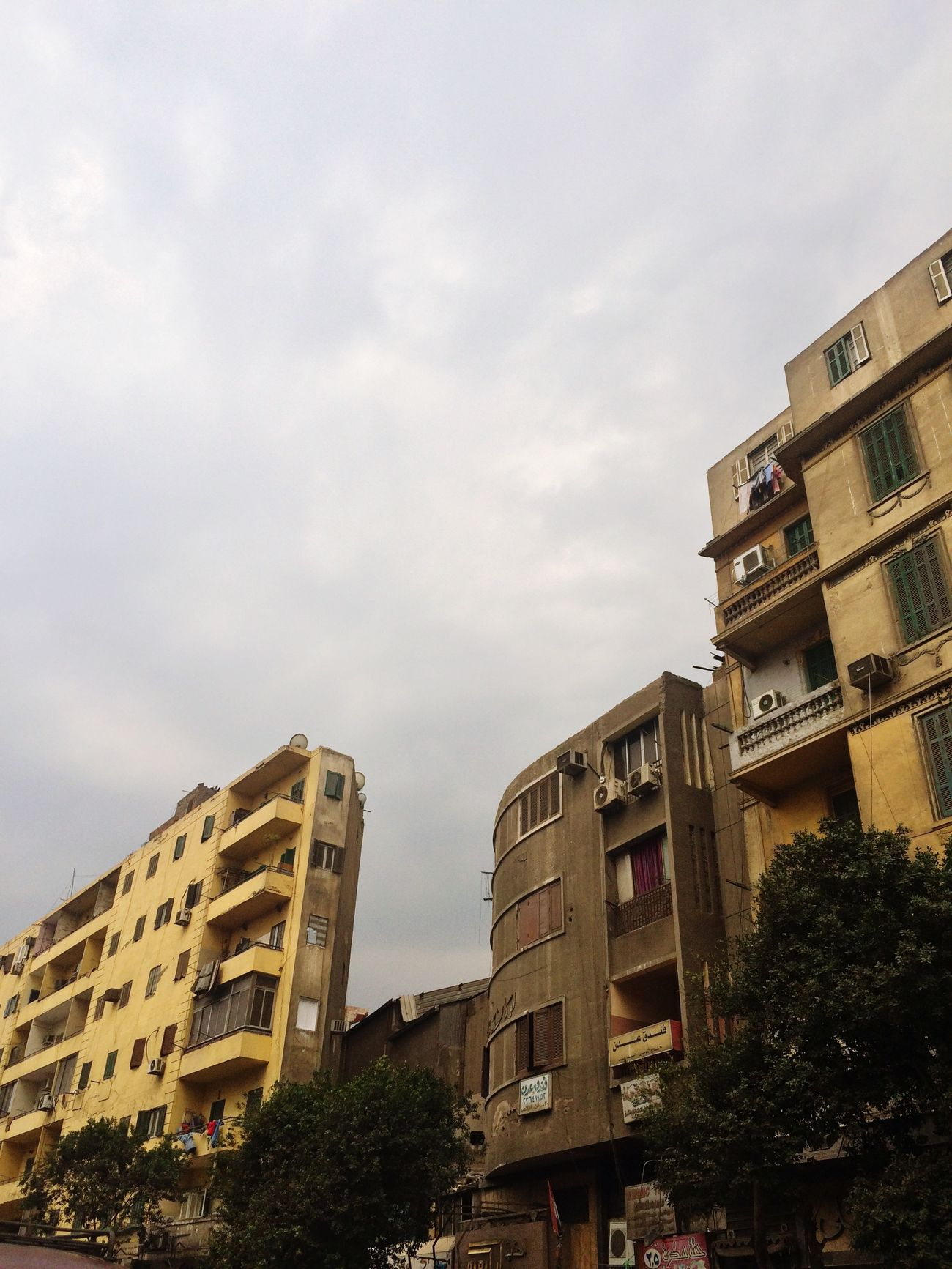 Building Exterior Architecture Built Structure Sky City Low Angle View No People Outdoors Residential Building Liveloveegypt Thisisegypt Livelovecairo مصر Iphonephotography IPhoneography Low Angle View Winter Clouds Clouds And Sky Cloud Cold Cold Temperature Cloud - Sky Day Tree