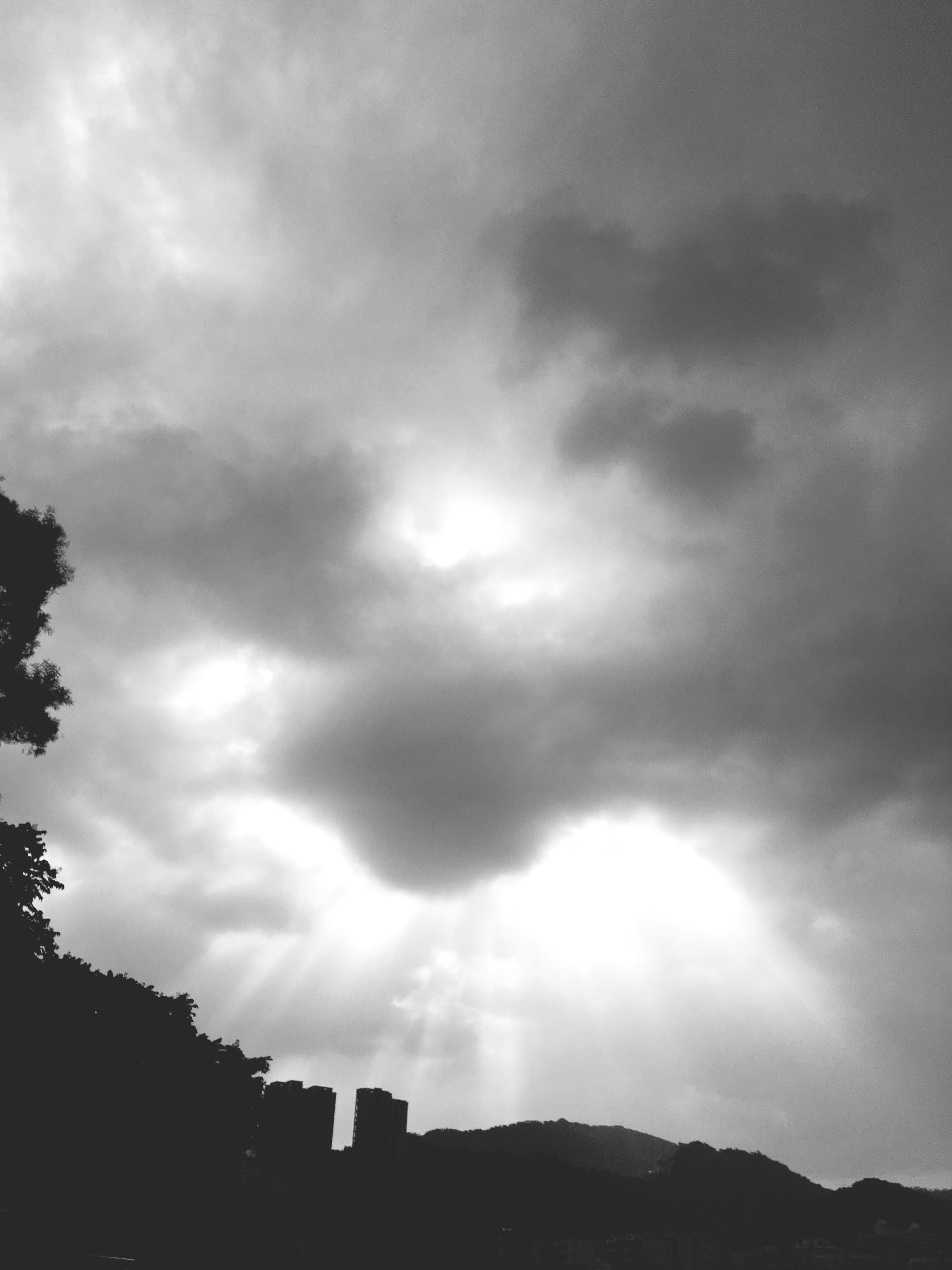 sky, cloud - sky, cloudy, low angle view, architecture, built structure, building exterior, weather, overcast, silhouette, storm cloud, cloud, nature, cloudscape, dusk, outdoors, beauty in nature, no people, building, day