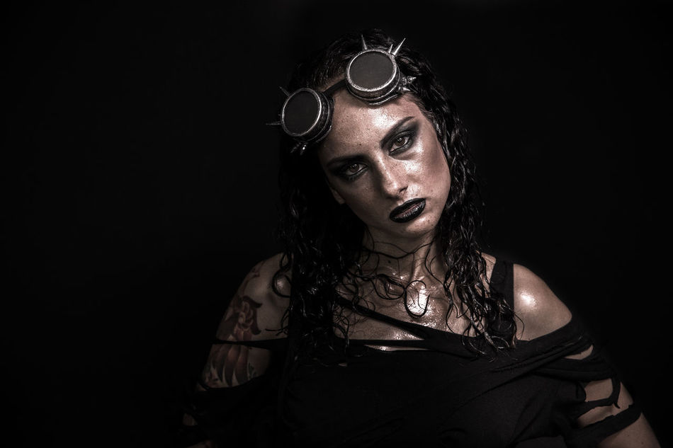 Portrait of Brutal Steampunk Girl over Black Background Black Background Brutal Girl Gothic One Person Portrait Shock Steampunk Tattoo Woman Young Adult