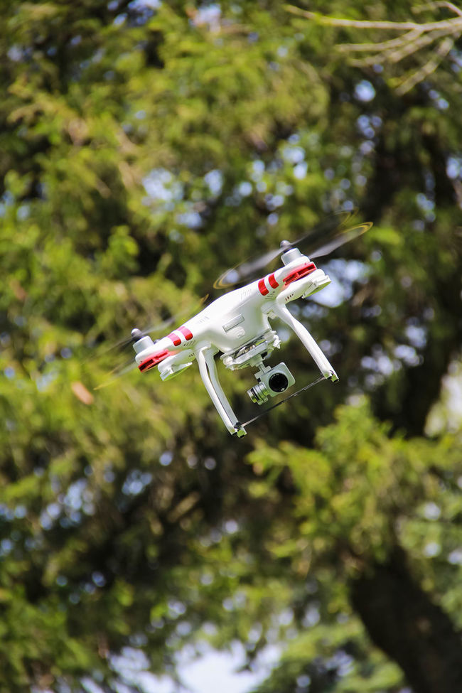 Capturing my husbands new toy. Drone  Flying Mid-air On The Move Photographing The Photographer Robot Selective Focus UFO