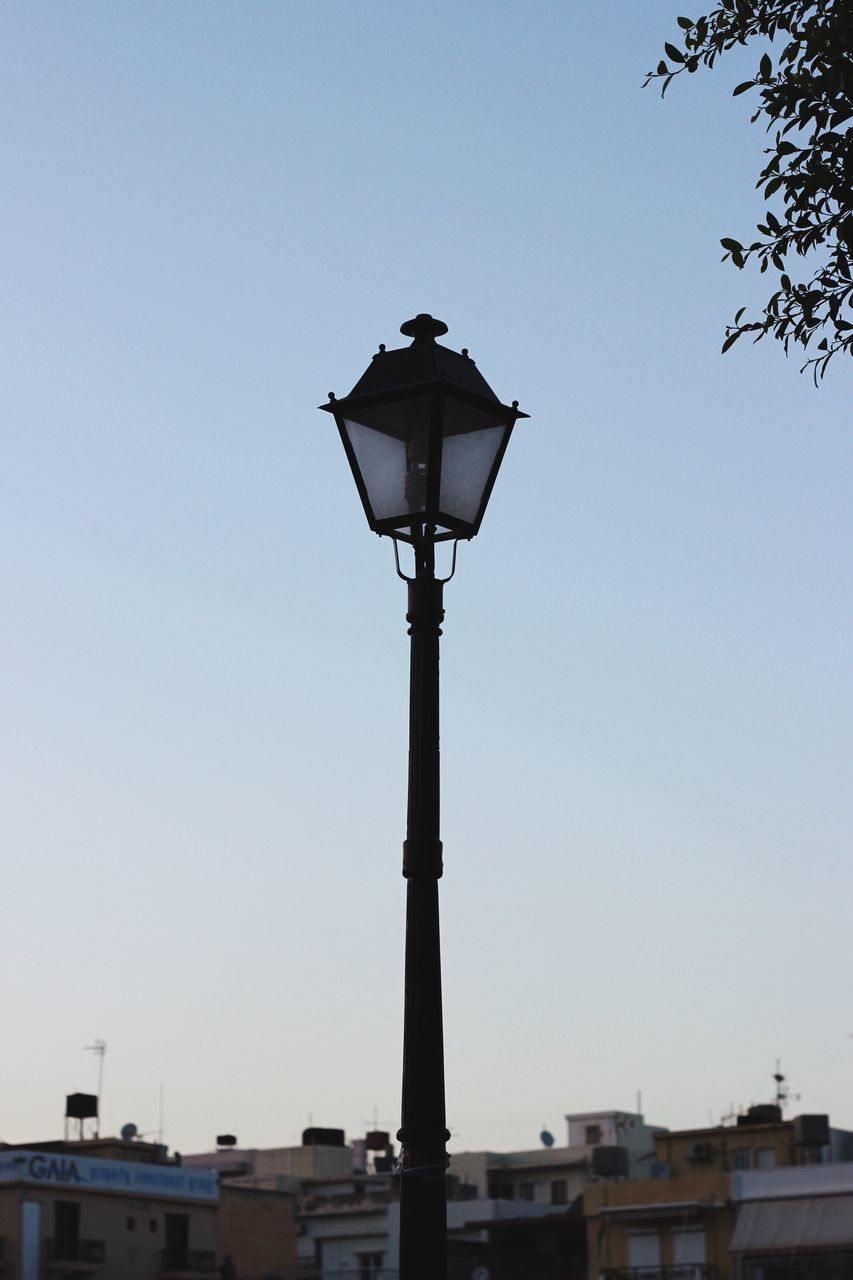 clear sky, low angle view, street light, no people, outdoors, blue, built structure, architecture, sky, building exterior, day