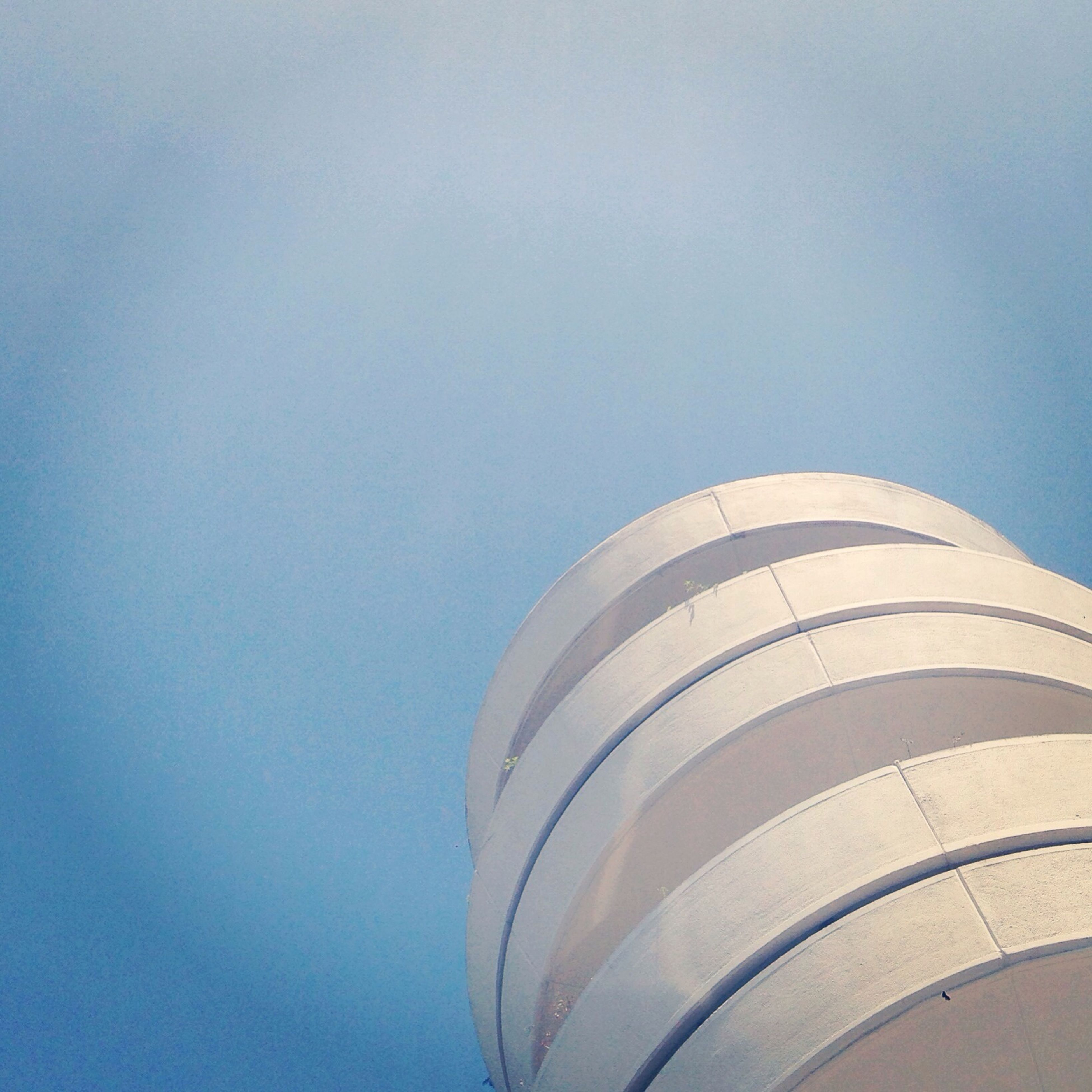 architecture, low angle view, built structure, building exterior, sky, copy space, blue, modern, clear sky, tower, day, city, no people, tall - high, high section, outdoors, building, part of, pattern, office building