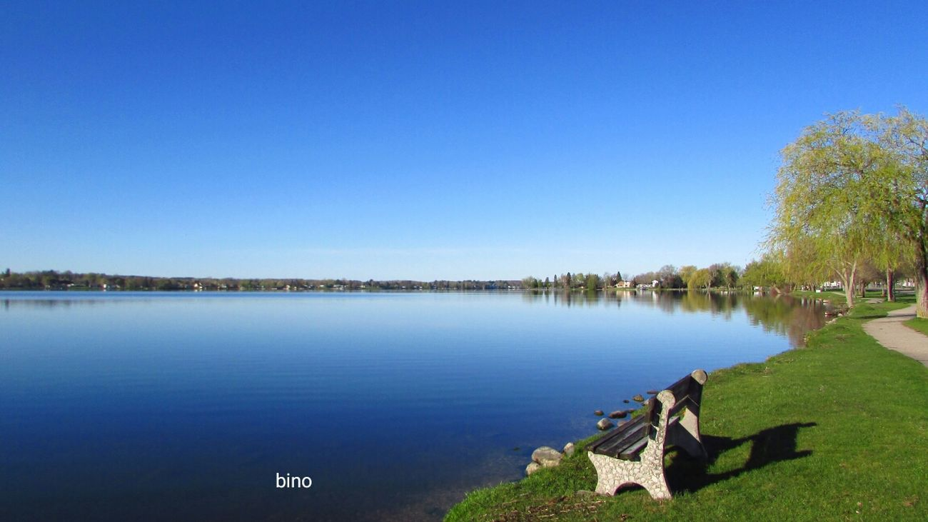 Early Morning At The Lake Tranquility Lone Bench Beauty In Nature Have A Seat Lake Like Glass So Blue Lake Cadillac Pure Michigan