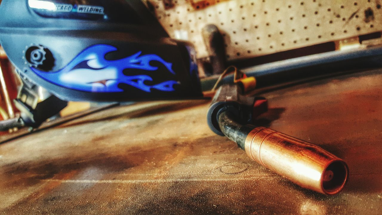 Time to get back to work Feeling Creative Getting Inspired Welding Tools Sculpture Metal Creating Creativity Workbench Helmet Welding Mask Blue Flames First Eyeem Photo Welder The Artist At Work ArtWork Craftmanship Copper  Showcase April