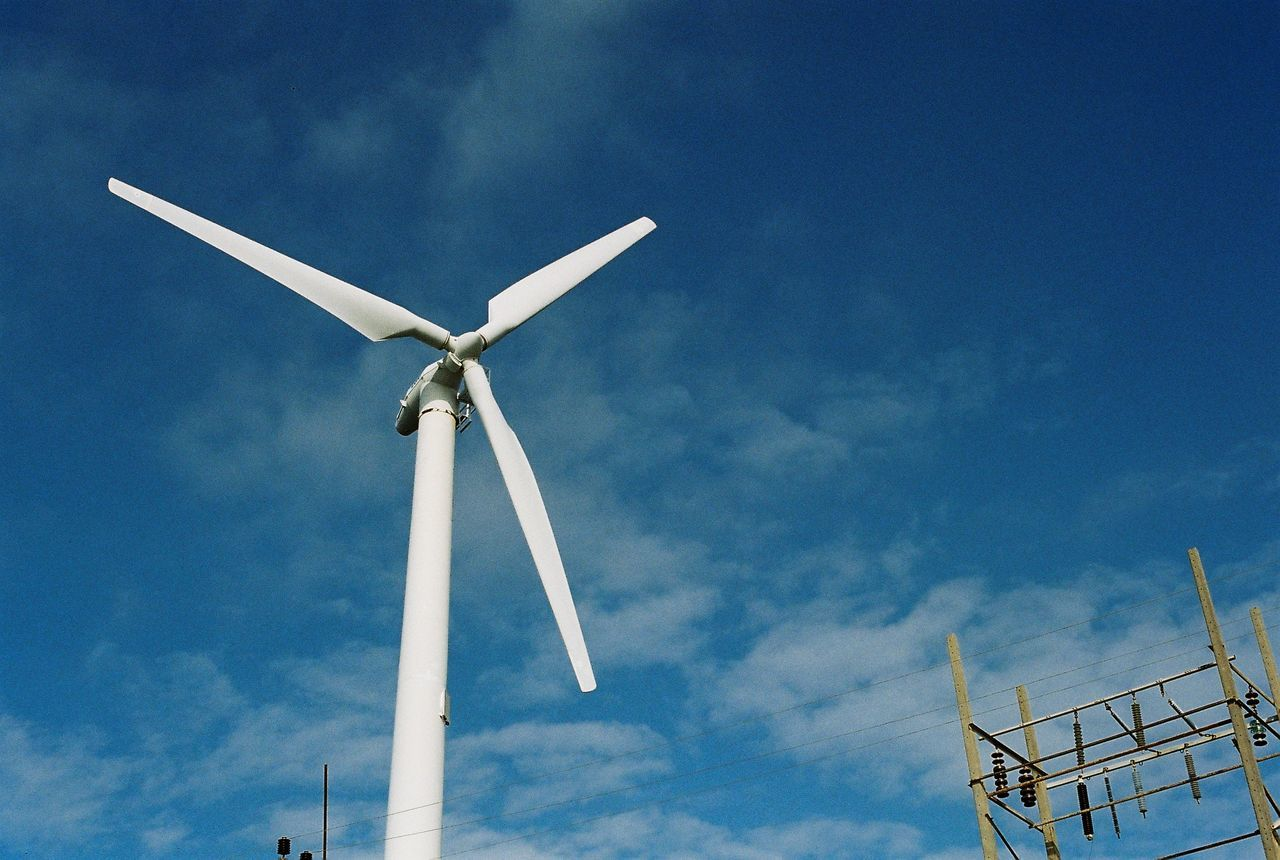 Alternative Energy Built Structure Cloud - Sky Day Environmental Conservation Film Photography Low Angle View No People Outdoors Renewable Energy Sky Technology Wind Power Wind Turbine Windmill