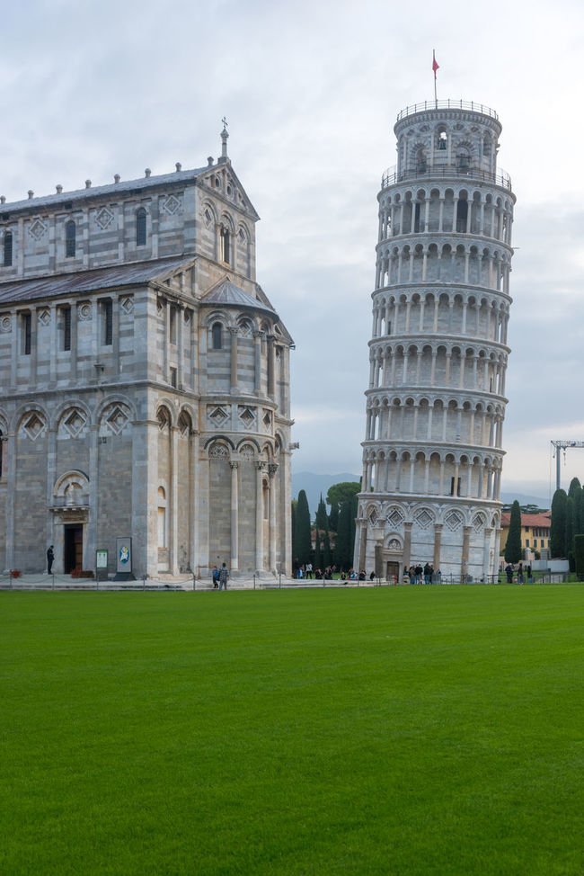Pisa, Italy - October 22, 2016: Tourists visiting the Leaning Tower of Pisa and Pisa Cathedral in Italy. The Tower of Pisa is one of Italy's most iconic tourist attractions and is famous worldwide for its unintended tilt. Architecture Building Exterior Built Structure City Day Grass Green Color History No People Outdoors Pisa Pisa Italy Pisa Tower Tourism Travel Destinations