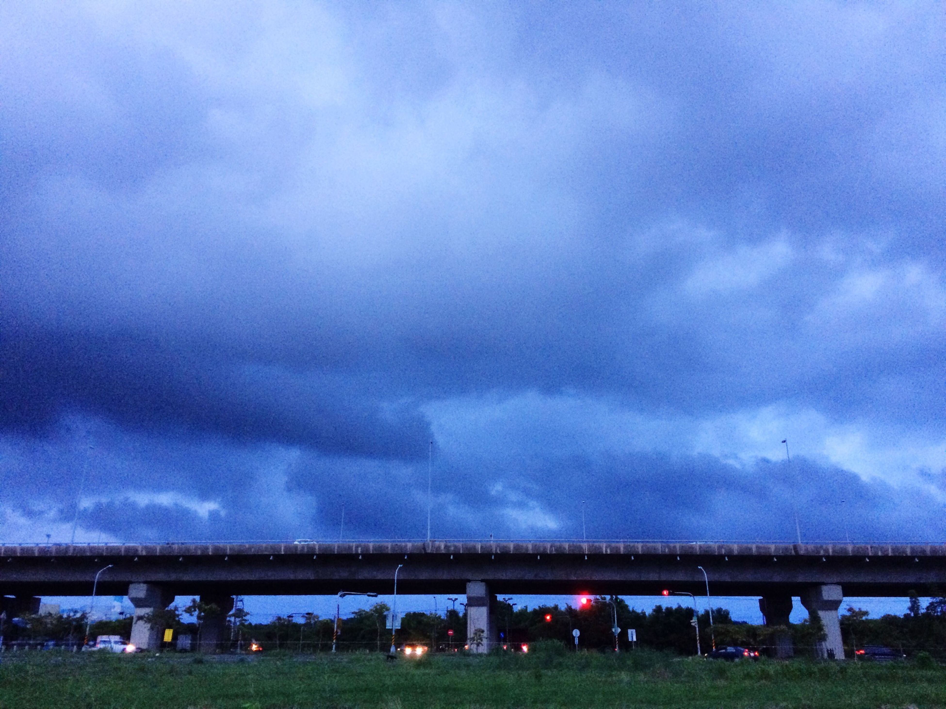 sky, cloud - sky, cloudy, connection, bridge - man made structure, built structure, architecture, transportation, cloud, weather, bridge, engineering, overcast, nature, river, day, outdoors, storm cloud, tree, tranquility