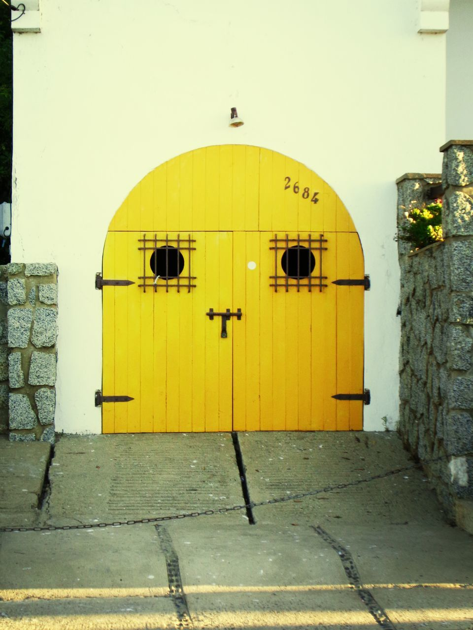 Exterior Of House With Closed Yellow Door