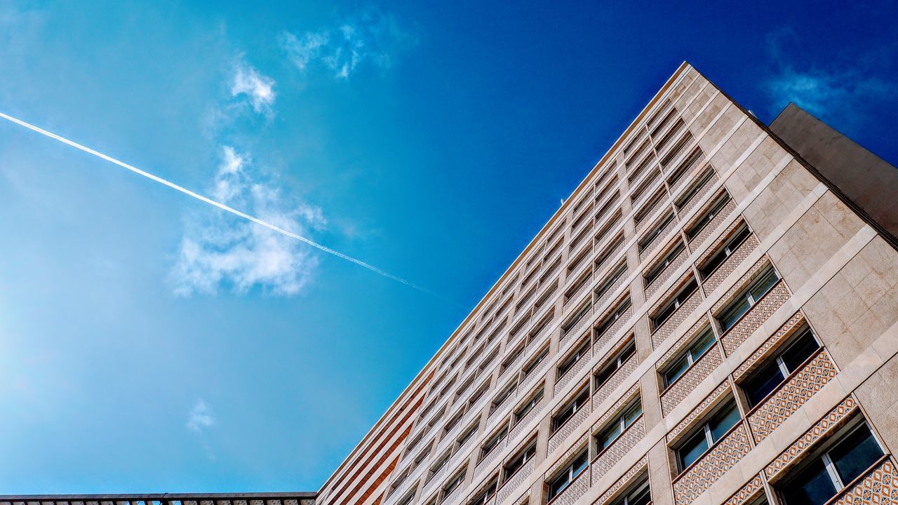 Architecture Blue Building Exterior Built Structure Day Low Angle View Modern Nature No People Outdoors Sky Vapor Trail