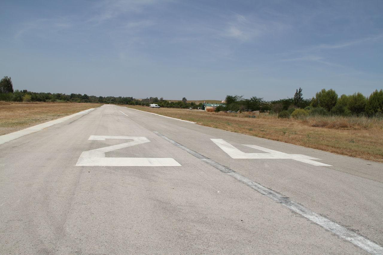 24 Airfield Airport Asphalt Day No People Outdoors Piste Runway Sky Straight Forward