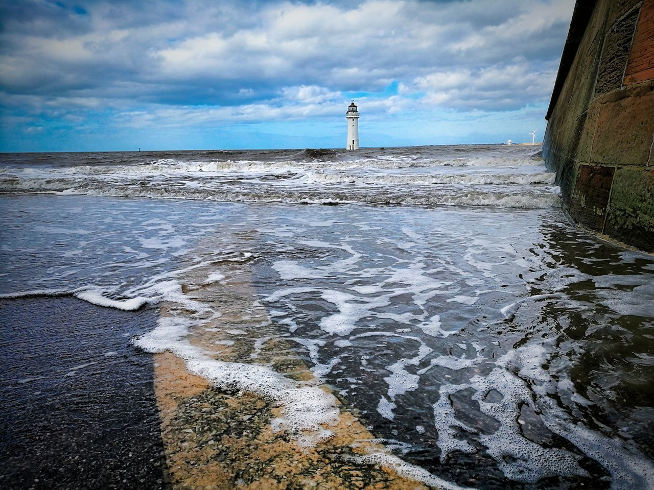 Follow the yellow line Sea Reflection Beach Outdoors Water Waves Crashing Waves Seaside Sea And Sky Leica Lens Huwei P9 EyeEmNewHere EyeEm Gallery Lighthouse Sky Nature Horizon Over Water Beauty In Nature Adult Day