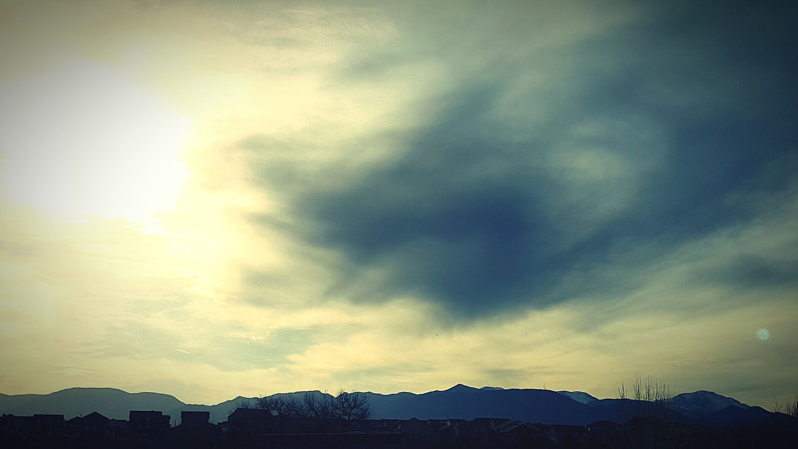mountain, sky, scenics, cloud - sky, beauty in nature, tranquil scene, mountain range, tranquility, weather, nature, silhouette, cloudy, sunset, cloud, idyllic, landscape, outdoors, low angle view, snow, dusk