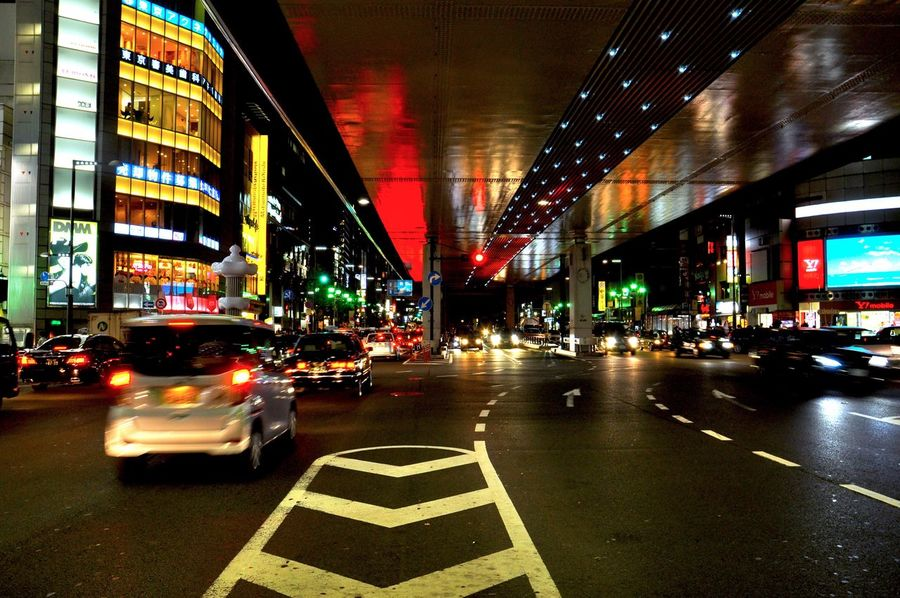 Street People Real People City Tokyo Outdoors Car Transportation City Illuminated Night Travel Destinations Land Vehicle Building Exterior Traffic Architecture City Life Road Neon No People Street
