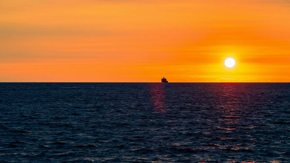 There's never an end for the sea. Beauty In Nature Horizon Horizon Over Water Idyllic Jupiter9 Nature Scenics Sea Sea And Sky Seascape Ship Silhouette Simplicity Sky Sun Sunset Tranquil Scene Tranquility Water Waves An Eye For Travel