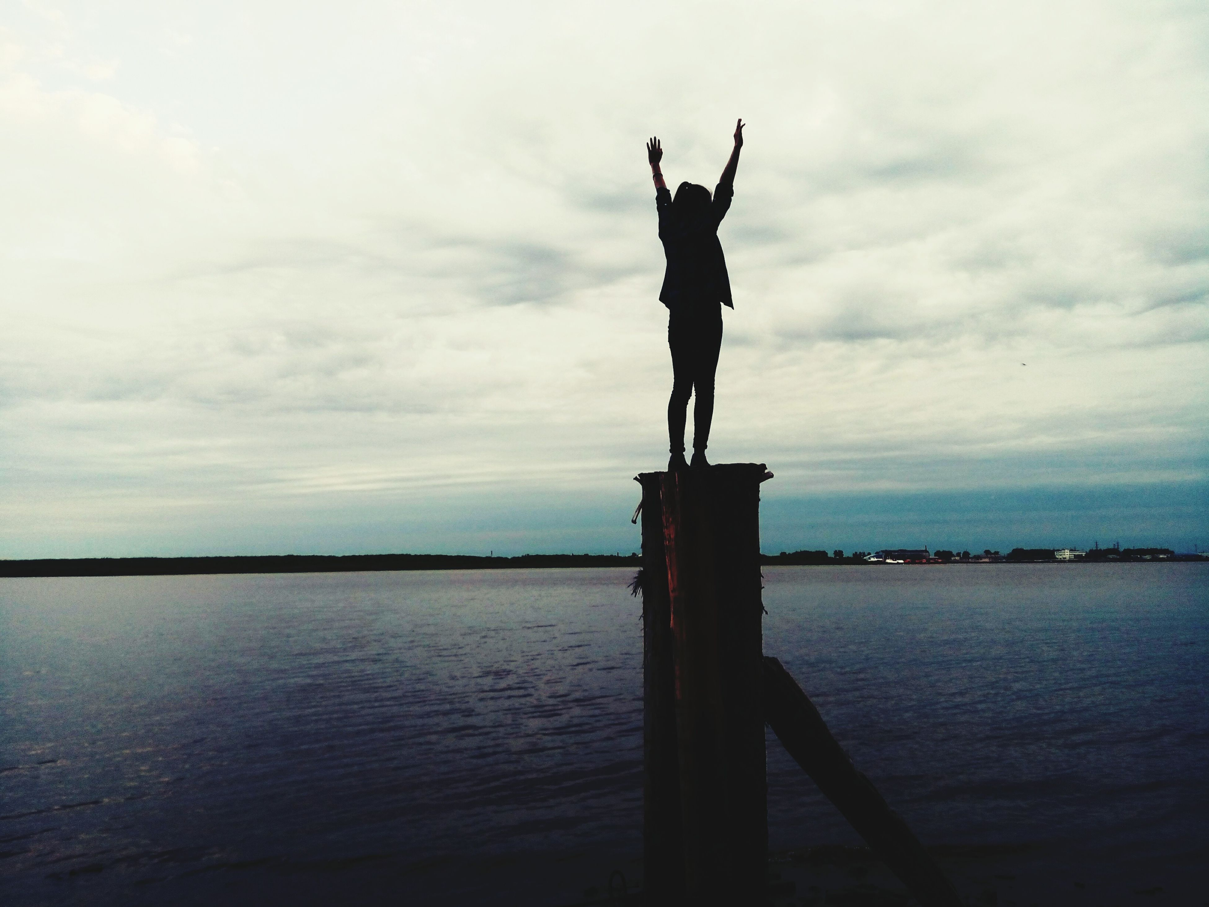 water, human representation, sky, statue, sculpture, sea, art and craft, art, cloud - sky, creativity, cloud, silhouette, tranquility, tranquil scene, waterfront, cloudy, scenics, horizon over water