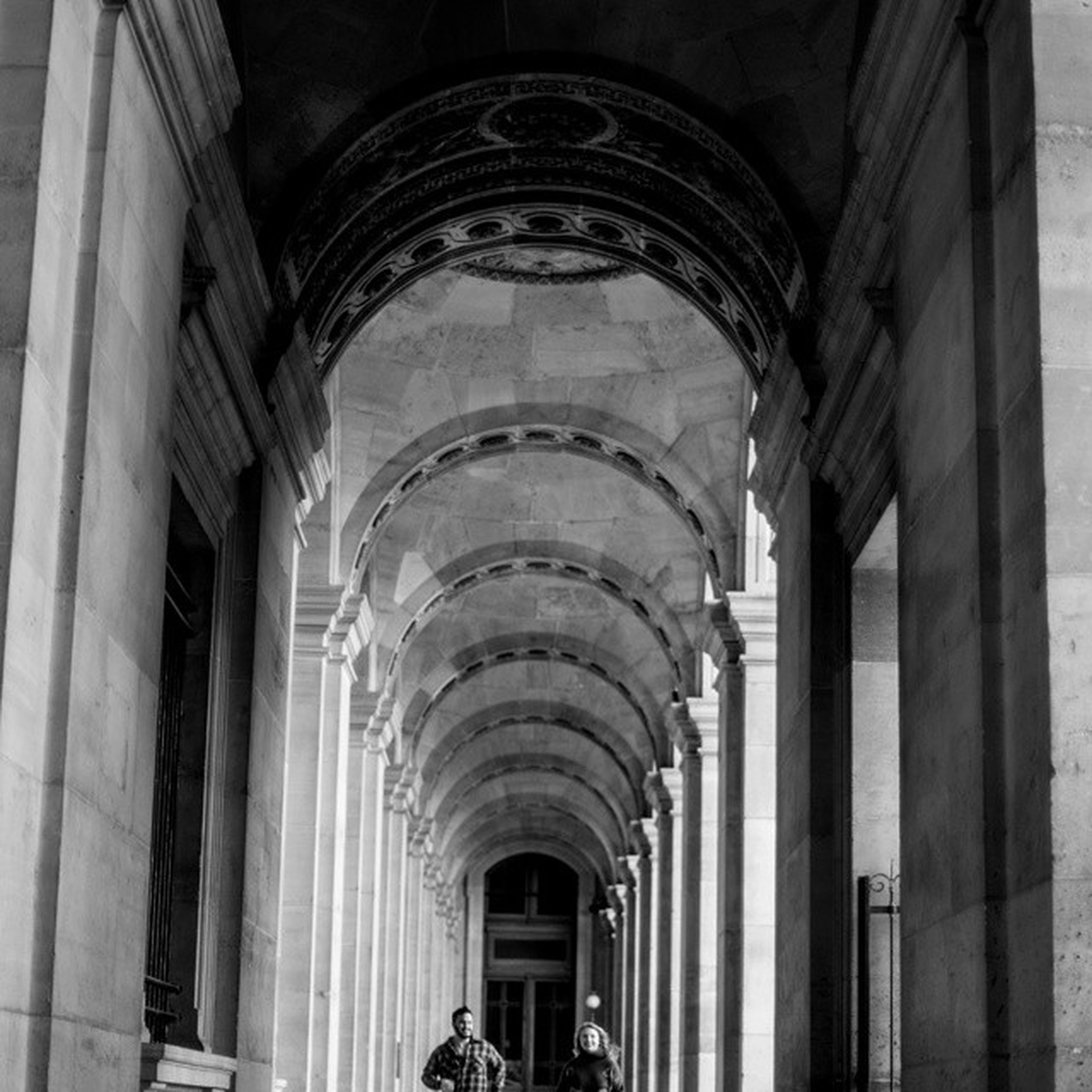 indoors, arch, architecture, built structure, architectural column, ceiling, column, history, low angle view, corridor, colonnade, interior, architectural feature, in a row, building, historic, window, famous place, travel destinations, ornate