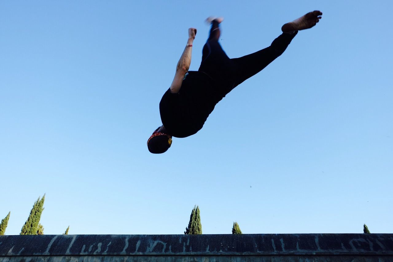 Mid-air Jumping Full Length Low Angle View One Person Real People Motion Clear Sky Day Men Tricking Acrobatics  Jump Jumpshot Sport Sports