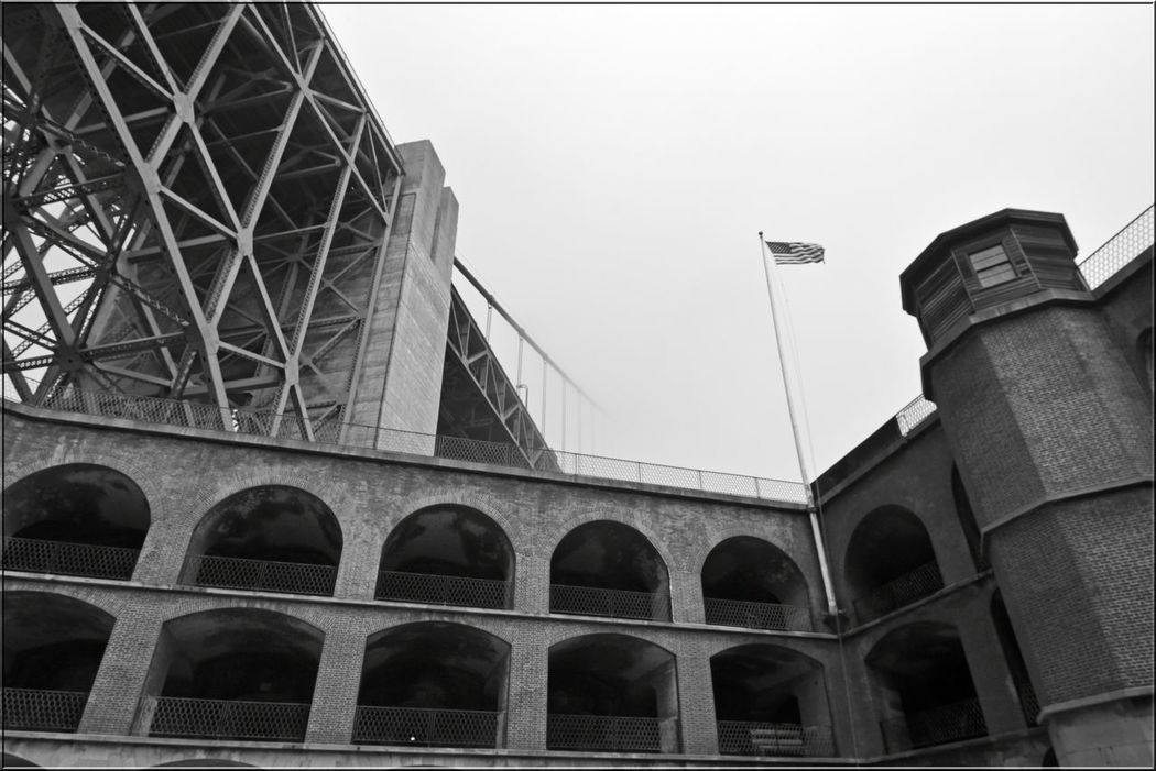 Golden Gate Bridge @ Fort Point 6 San Francisco Bay Golden Gate Bridge 1937 Fort Point 1861 Military Base Fog Foggy Day Bnw_friday_challenge Barracks Bridge Span Diminishing Perspective Low Angle View U.S. Flag Vanishing Point Architecture Fort Structure Brick & Mortar Arches Monochrome Black & White Black And White Photography Black And White Black And White Collection