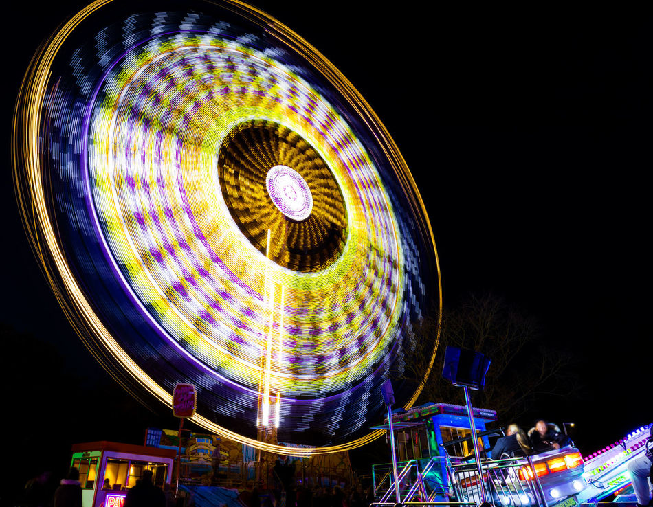 All the fun of the fair! The ride was called over the top..... this was over the top, and over and over again Attraction Blue Canon Canon 5d Mark Iv Canonphotography Circle Entertainment Evening Fun Funfair Funfair Ride Light Trail Lights Night Nightphotography Purple Ride Slow Shutter Speed Winter Yellow