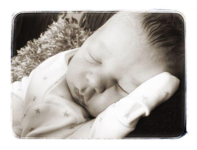My newly born grandchild Headshot Person Resting