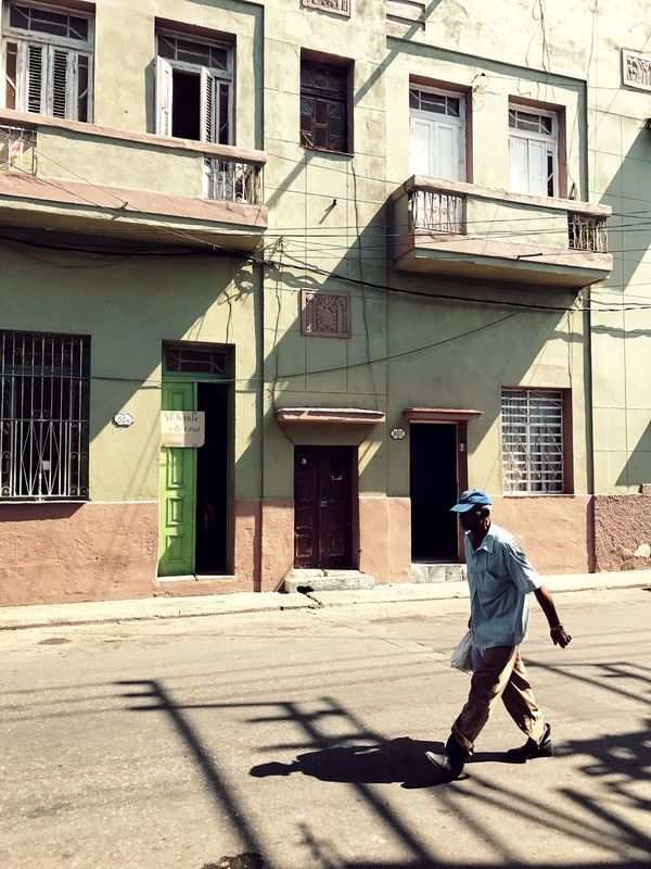 - Day walker Eye4photography  Eyeemphoto EyeEmBestPics EyeEm Gallery EyeEm Best Shots EyeEm Travcimages Iphoneonly ShotOnIphone IPhoneography Streetphotography Havana, Cuba Cuba Building Exterior Architecture Built Structure One Person Full Length Shadow Men Sunlight Walking Day Outdoors