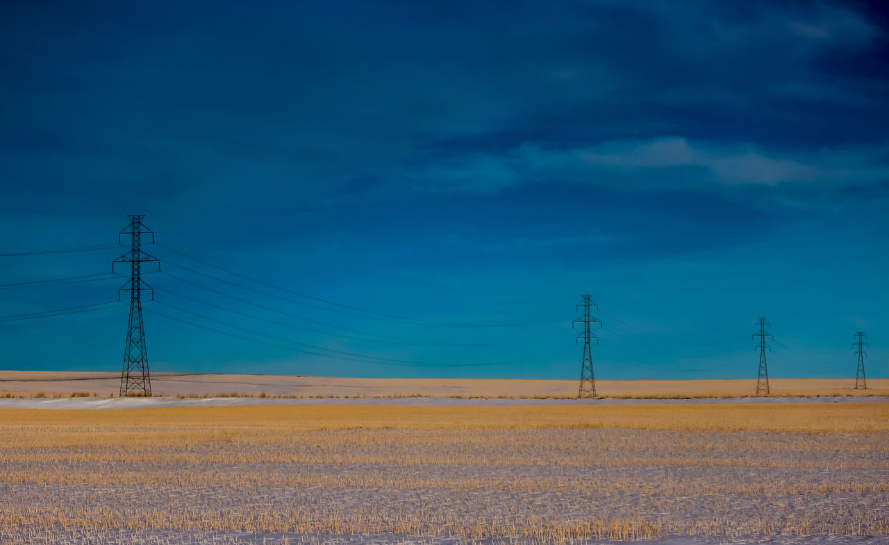 On the prairies in the winter Blue Cable Cloud - Sky Day Electricity  Electricity Pylon Electricity Tower Field Fuel And Power Generation Landscape No People Outdoors Power Line  Power Supply Priaries Scenics Sky Technology