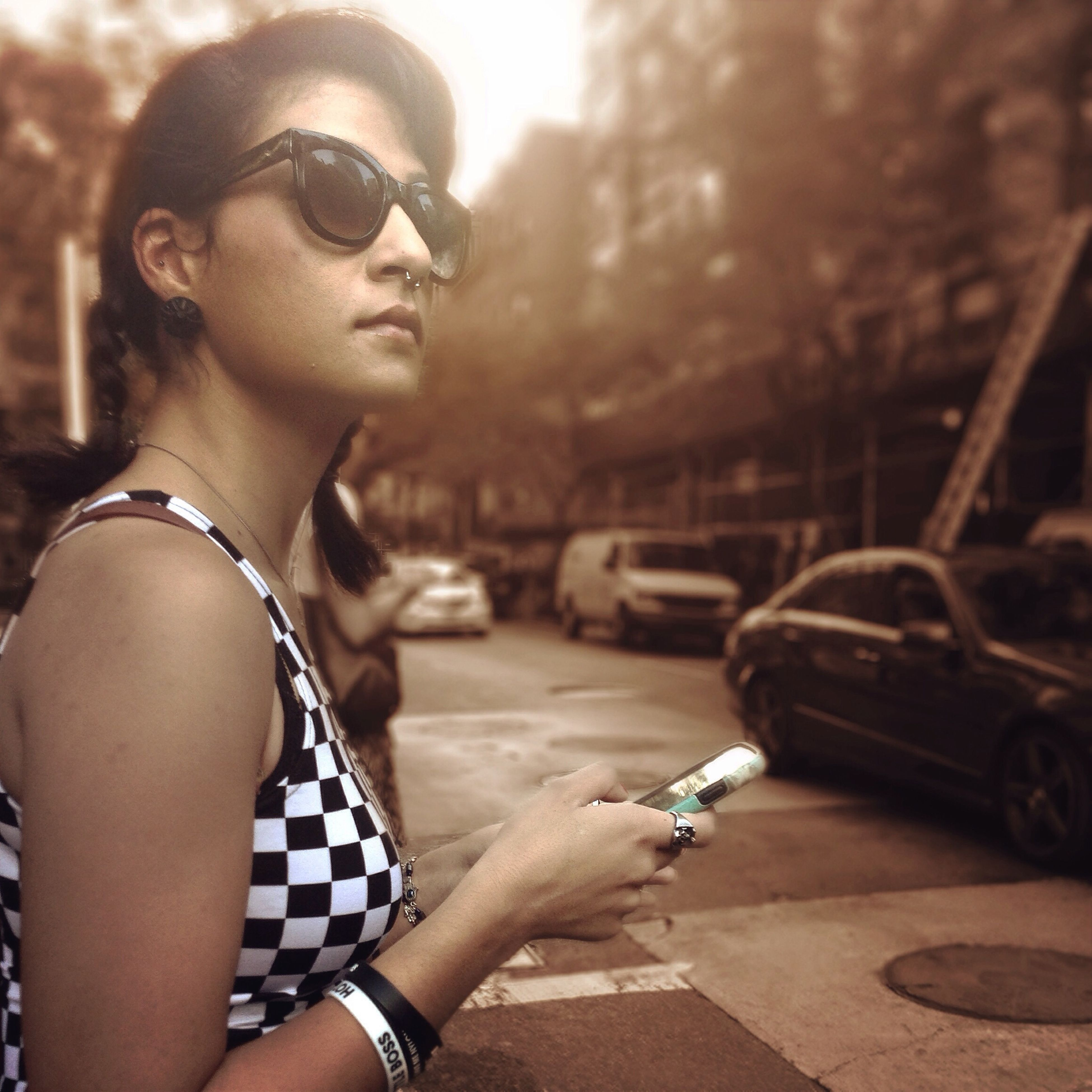 young adult, lifestyles, person, leisure activity, portrait, looking at camera, young women, sunglasses, front view, casual clothing, focus on foreground, smiling, fashion, side view, building exterior, mid adult