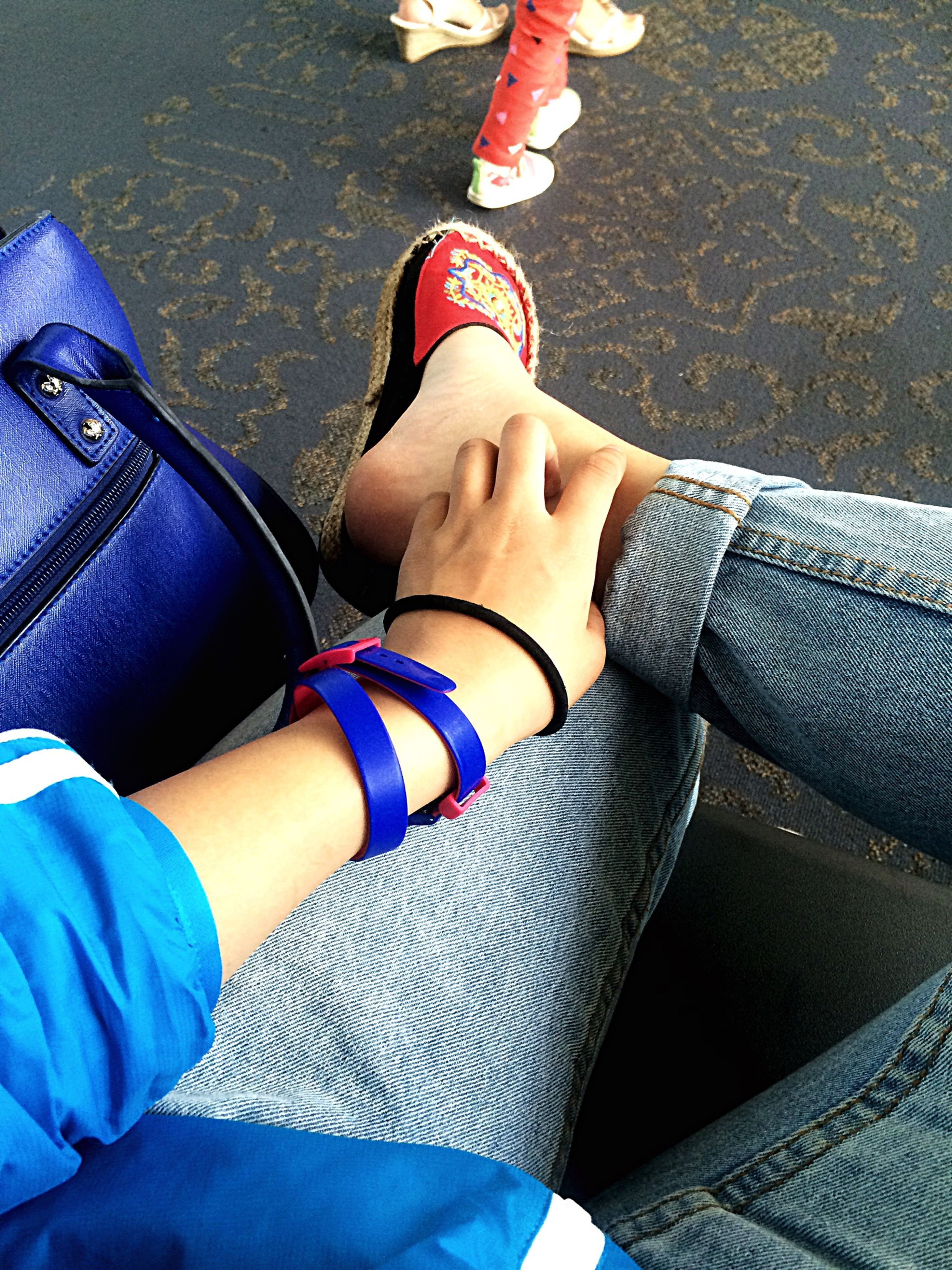 low section, person, lifestyles, shoe, leisure activity, casual clothing, high angle view, jeans, blue, standing, sitting, human foot, personal perspective, footwear, fashion, men