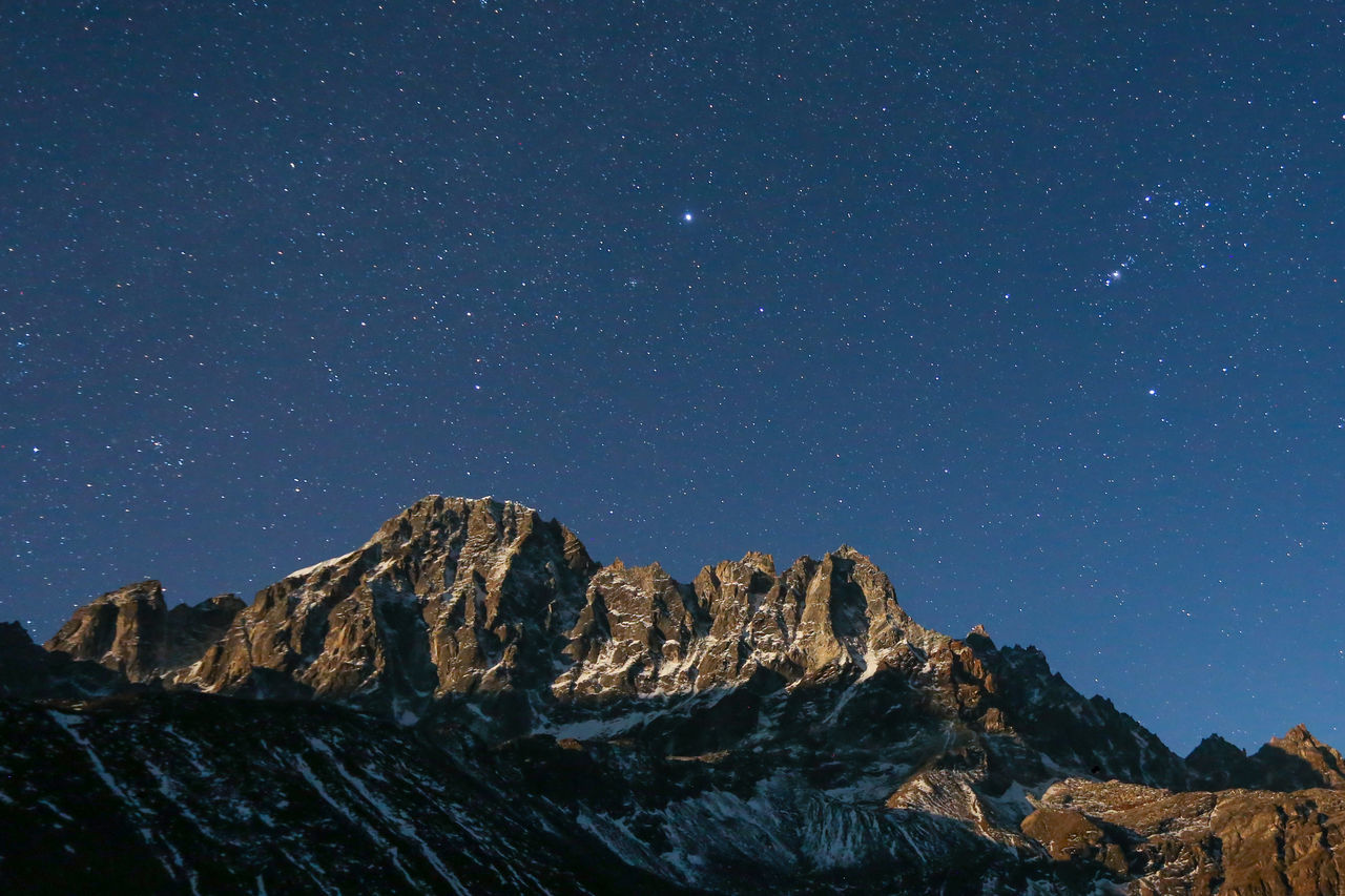 mountain, star - space, nature, rock - object, scenics, no people, astronomy, beauty in nature, mountain range, galaxy, tranquil scene, physical geography, tranquility, outdoors, sky, clear sky, snow, night, space, constellation