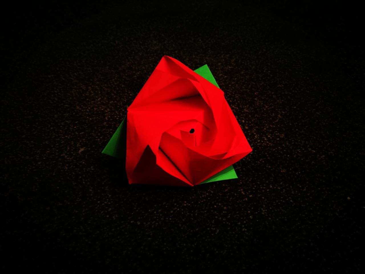 red, paper, no people, indoors, black background, close-up, day