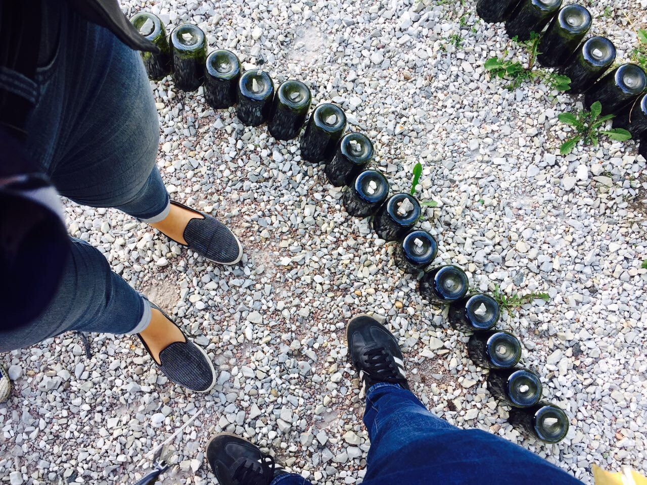 Shoe Human Body Part Human Leg Low Section High Angle View Standing Outdoors Real People Men Day One Person People Legs Adult Human Hand Adults Only Outdoor Bottles Collection Out Of The Box