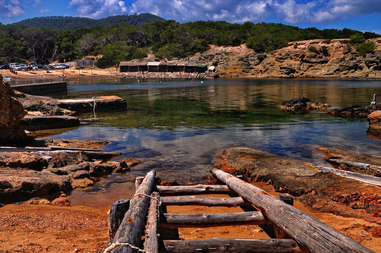 EyeEm Selects Water Outdoors Coast Travel Destinations Tourism Mediterranean Sea Eivissa Ibiza Tourist Attraction  Landscape Nature Beach Sea Pou Des Lleó Spaın Balearic Island Slipways To Sea Cove Fishing Port Boat Houses Typical Santa Eulària Des Riu