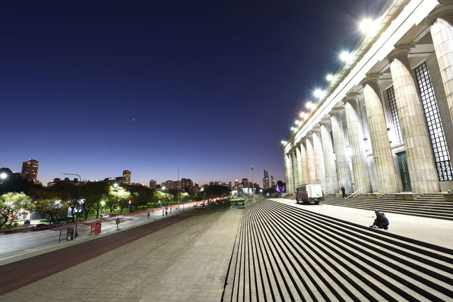 The blue hour in Buenos Aires Architecture Blue Buenosaires Building Exterior Built Structure City City Life Clear Sky Cobblestone Diminishing Perspective Footpath Illuminated Incidental People Long Modern Night Outdoors Pedestrian Walkway Promenade Sky Street Street Light The Way Forward Travel Destinations Walkway