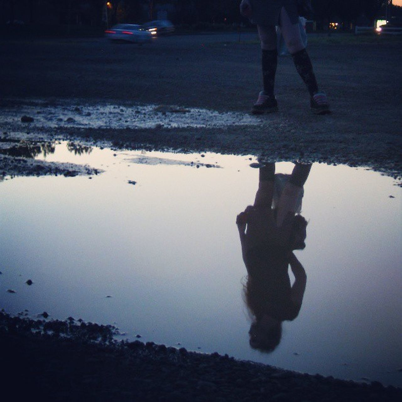 walking, real people, low section, reflection, puddle, human leg, water, one person, standing, outdoors, men, day, nature, human body part, sky, people