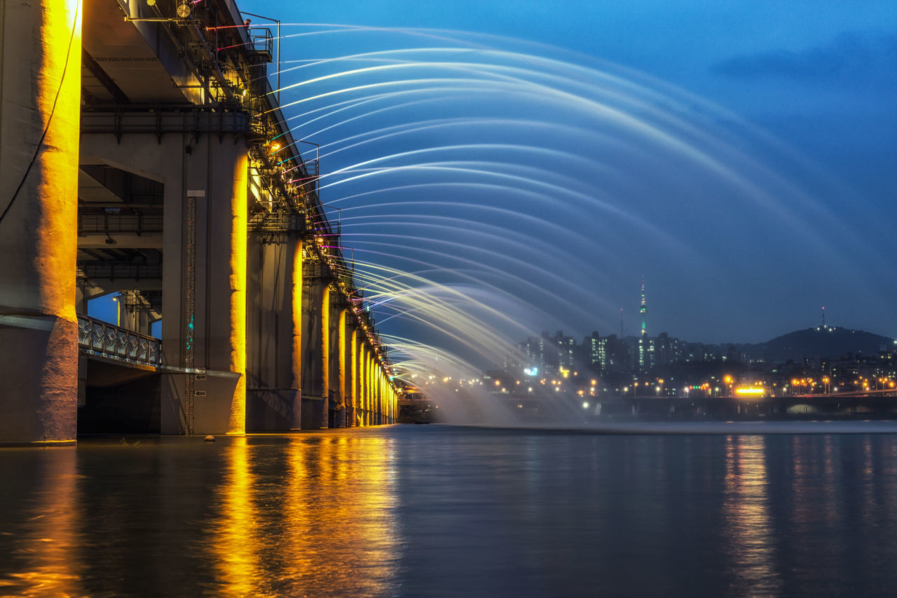 banpo bridge rainbow fountain show in seoul, south korea taken at night over the han river. N Seoul Tower in the distance. The rainbow fountain changes color according to the music playing from the bridge. ASIA Asian  Banpo Banpo Bridge Banpo Hangang Park Banpodaegyo Beauty In Nature Bridge - Man Made Structure Built Structure City City Cityscape Han River Illuminated Korea Korean Night Rainbow Fountain River Seoul Sky Urban Urban Landscape Water Waterfront