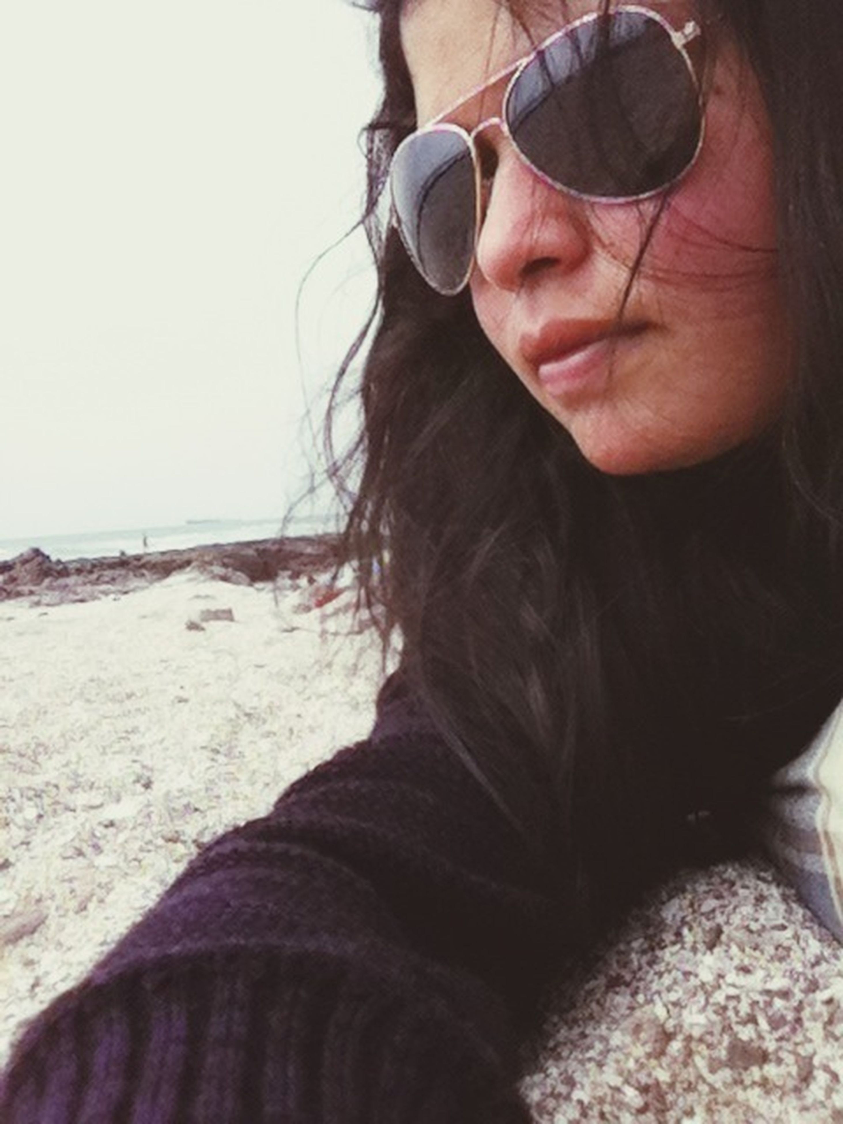 sunglasses, lifestyles, leisure activity, young adult, headshot, person, beach, close-up, young women, head and shoulders, sunlight, portrait, sea, looking at camera, casual clothing, front view, day, focus on foreground