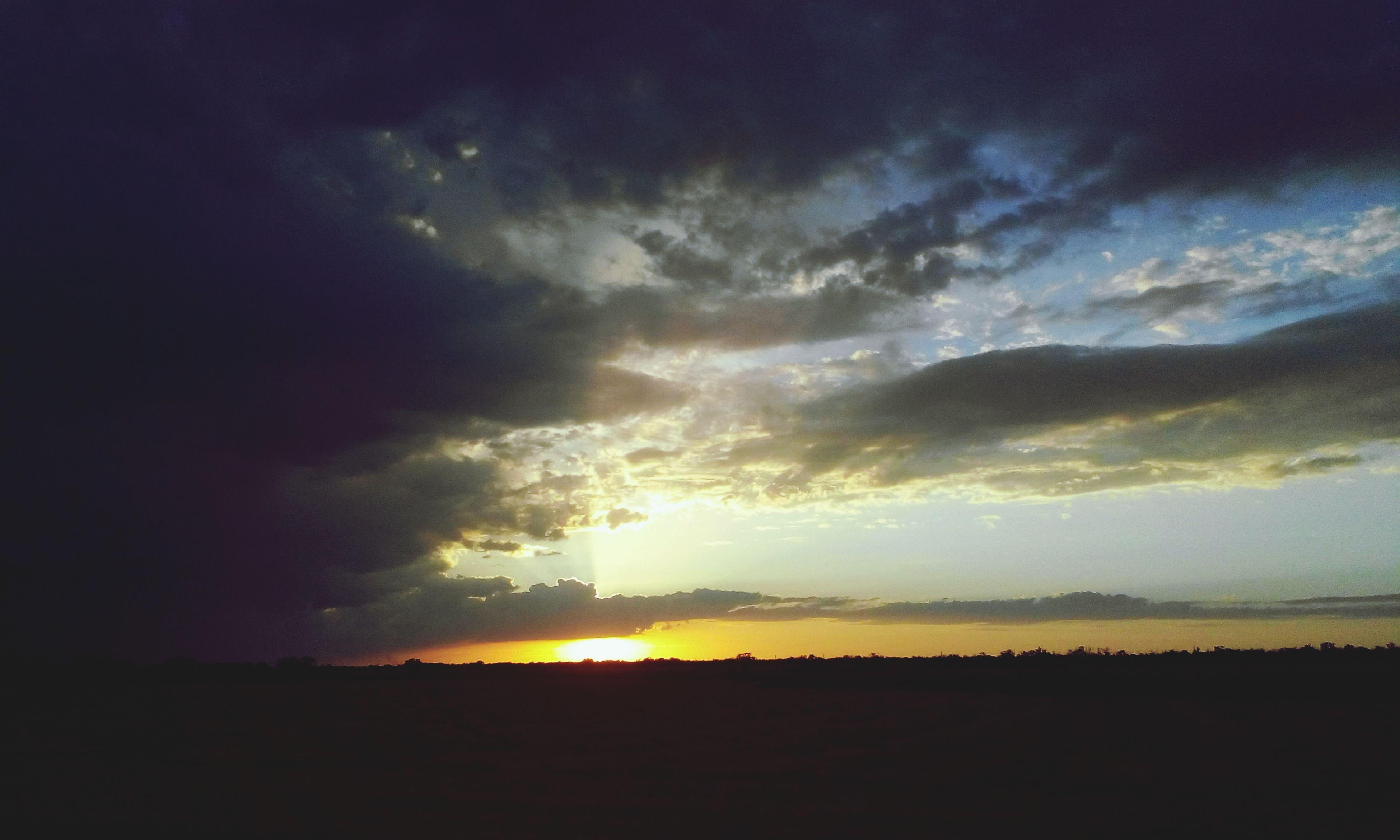 sunset, sky, tranquil scene, scenics, beauty in nature, tranquility, landscape, silhouette, cloud - sky, sun, nature, idyllic, field, cloud, sunlight, sunbeam, dramatic sky, cloudy, outdoors, orange color