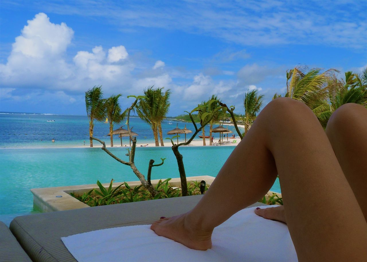 Beach Blue Clouds EyeEm Best Shots Hello World Horizon Over Water Human Body Part Legs Mauritius Ocean On The Beach Palm Trees Poolside Relaxing Sky Summer Sunbathing Sunbed Swimming Pool Taking Photos Turquoise Vacation Woman