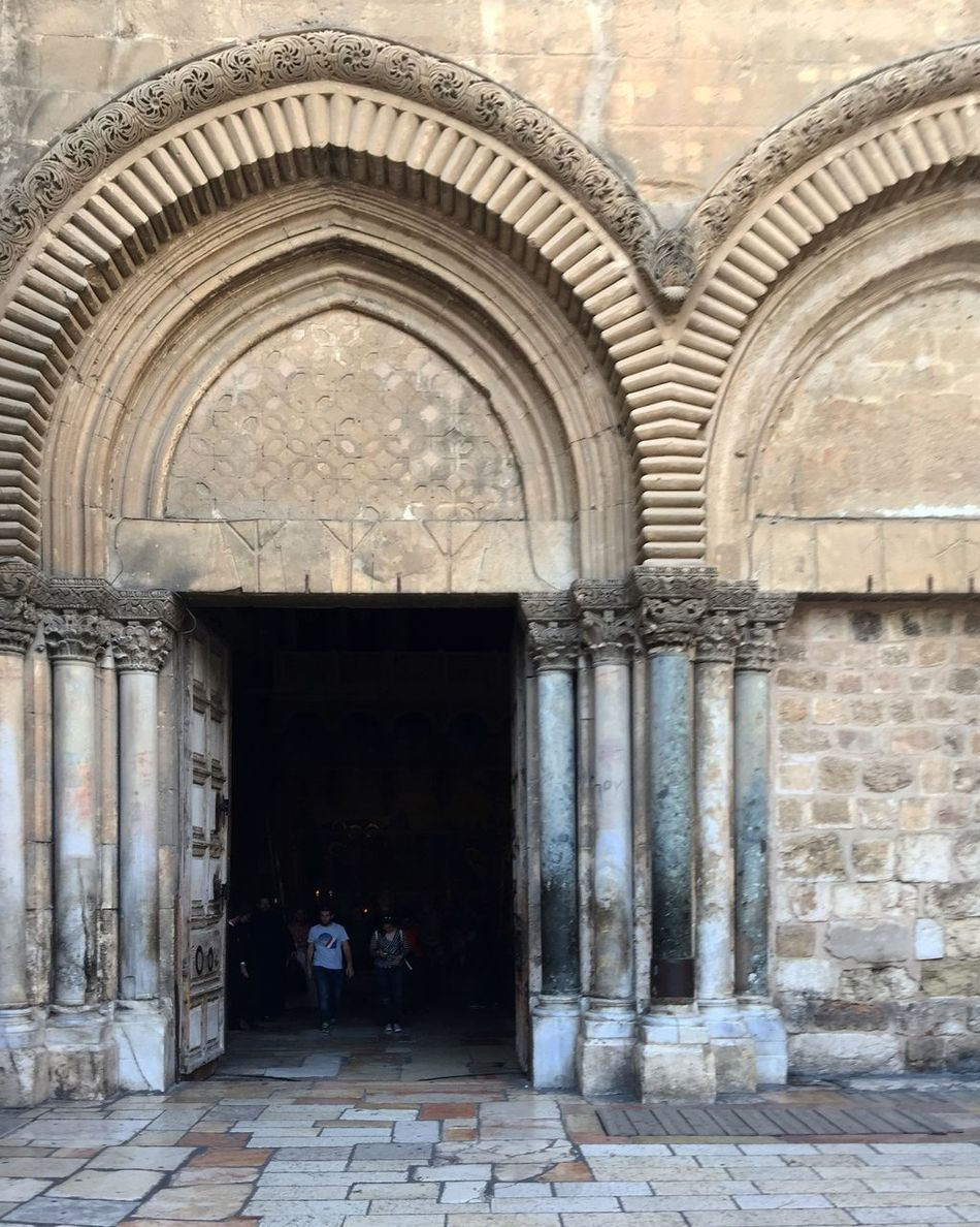 Entrance to the Church of the Holy Sepulchre, Jerusalem, Israel Arch Architecture Architecture Building Exterior Built Structure Church Of The Holy Sepulchre Entrance Full Length History Holy City Israel Jerusalem Travel Two People