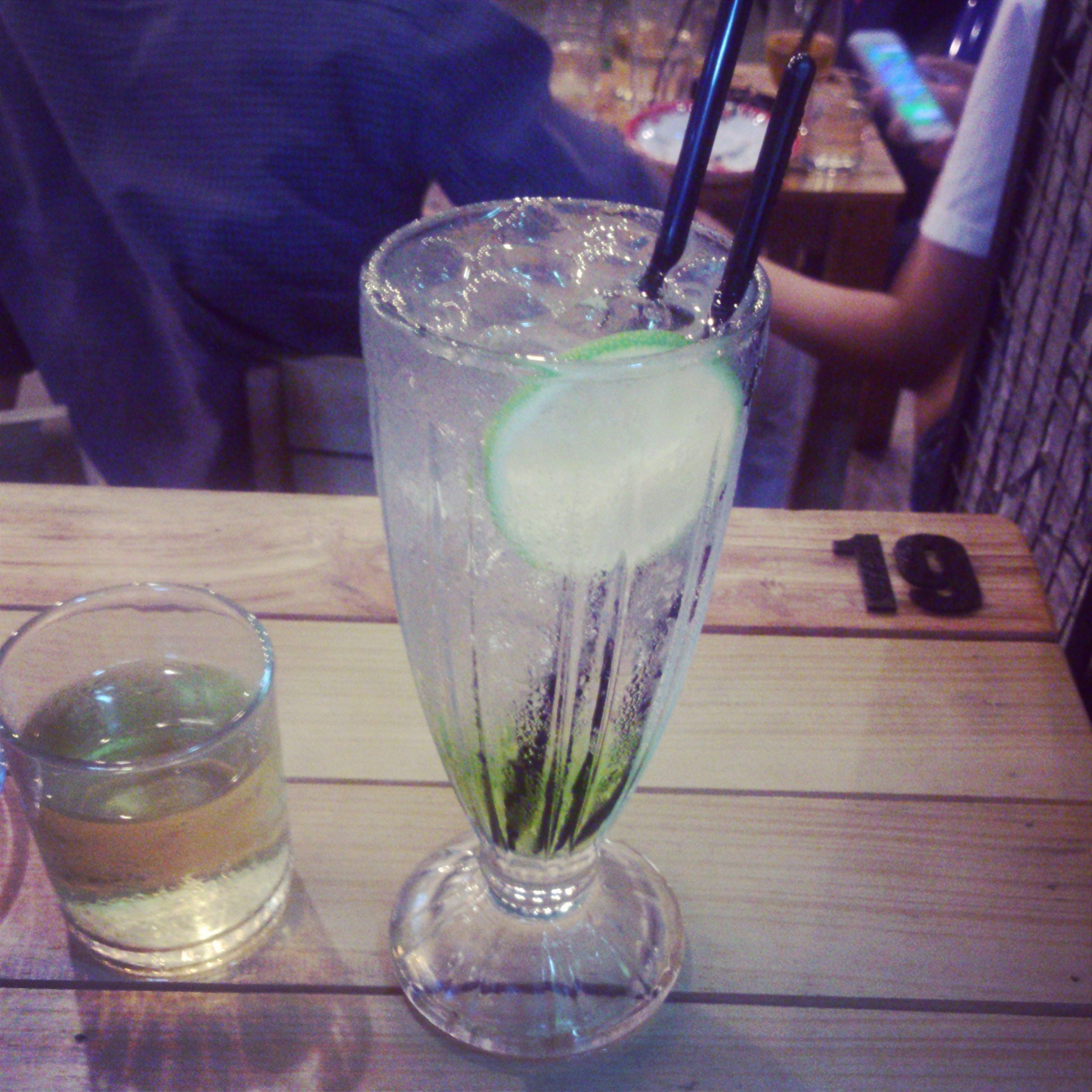 drink, food and drink, drinking glass, refreshment, table, freshness, alcohol, glass - material, indoors, drinking straw, still life, cocktail, close-up, transparent, glass, wineglass, restaurant, juice, focus on foreground, ice cube