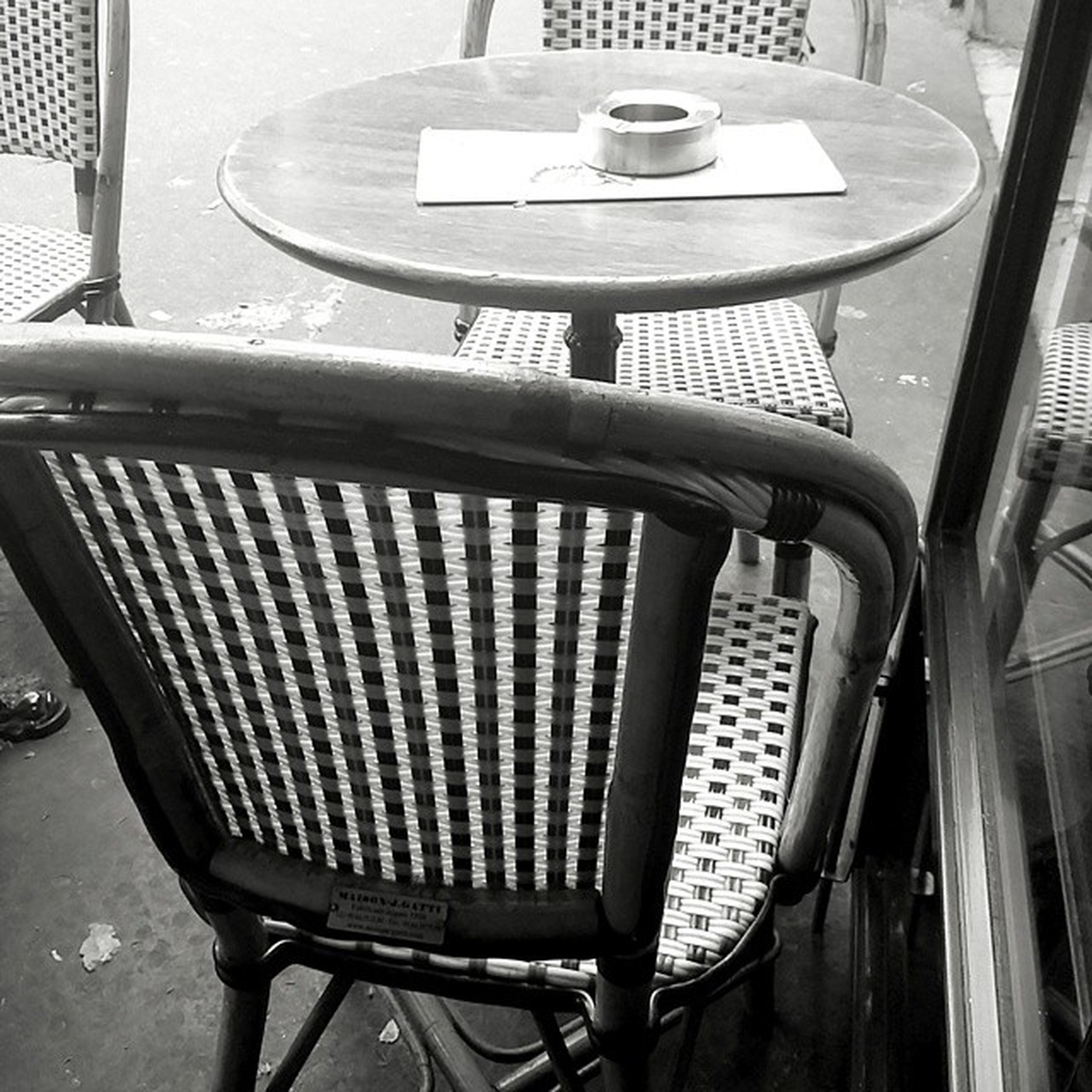 chair, indoors, metal, table, absence, empty, no people, lighting equipment, day, metallic, close-up, seat, hanging, old-fashioned, sunlight, still life, focus on foreground, built structure, railing