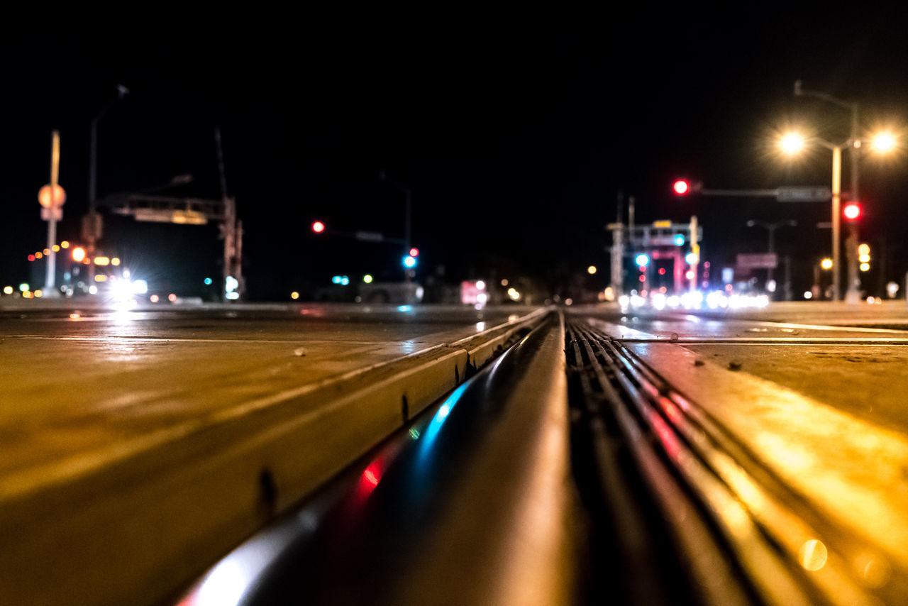 illuminated, night, transportation, speed, light trail, mode of transport, motion, long exposure, railroad track, train - vehicle, blurred motion, rail transportation, street light, no people, road, outdoors, high street, city