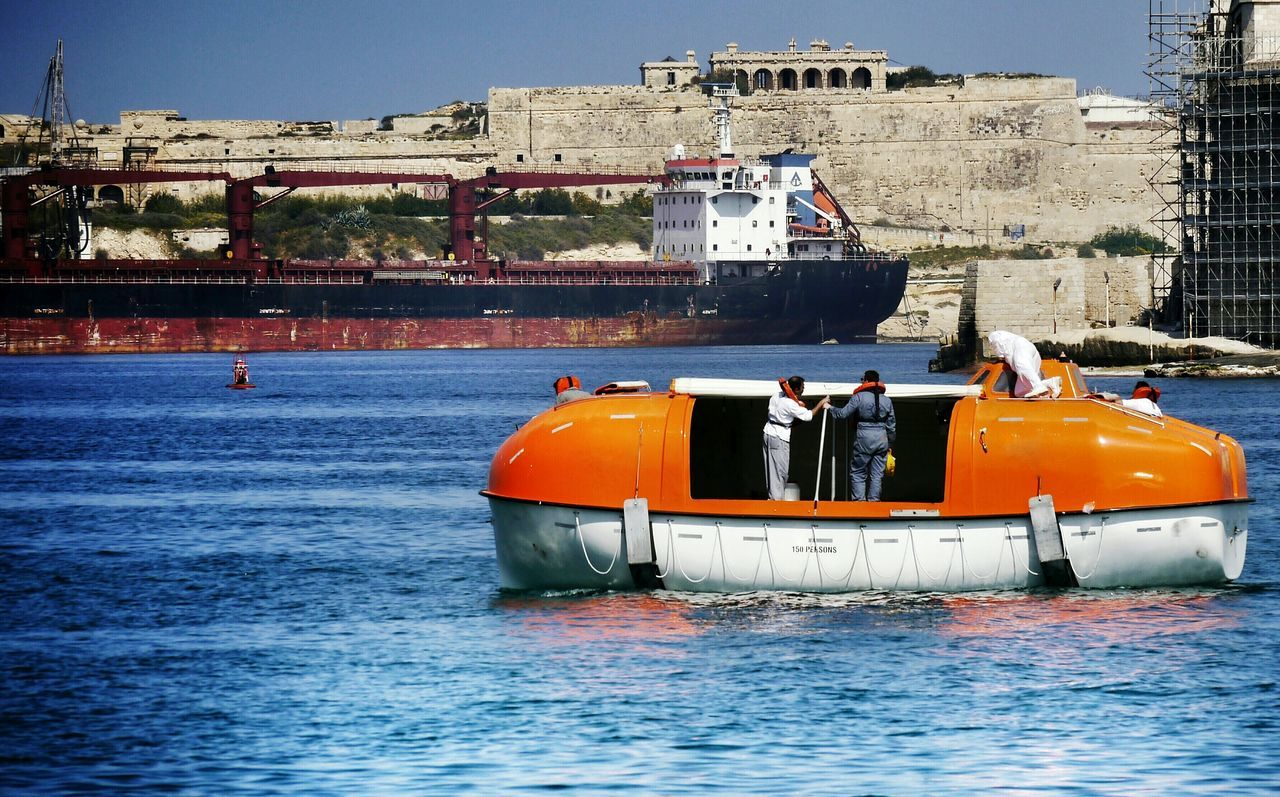 save lives on the ocean People Of The Oceans Travel Cruise Rescue Rescue Team Be Prepared Test Savety Men Working Harbour Orange Color Sea Life Sunny Day Lifeboat RescueLife